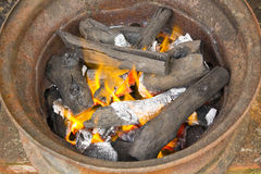 Burning charcoal in metal rim Stock Photography
