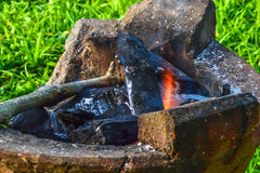 Burning charcoal in old stove Stock Images