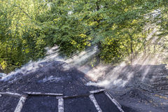 Burning charcoal pile in the forest Stock Photos