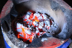 Burning charcoal. On the stove Stock Image