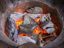 Burning charcoal in stove. Close up burning charcoal in old stove Royalty Free Stock Photography