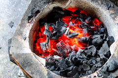 Burning charcoal in a stove Stock Images