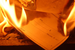 Burning checks Royalty Free Stock Image