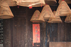 Burning chinese circular joss sticks and couplet Royalty Free Stock Photos