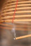 Burning chinese circular joss sticks Royalty Free Stock Photography