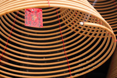 Burning chinese circular joss sticks and wish card Royalty Free Stock Photography