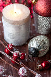 Burning Christmas candle and Christmas decorations Stock Photo