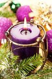 Burning Christmas candle and Christmas toys Stock Image