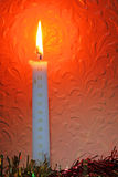 Burning Christmas candle. Royalty Free Stock Image