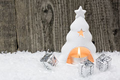 Burning Christmas candle and small Royalty Free Stock Photo