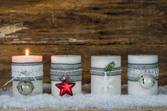 Christmas candles decorated with ornaments for Advent Season. Burning Christmas candlelights for festive Advent season, first Advent royalty free stock photos