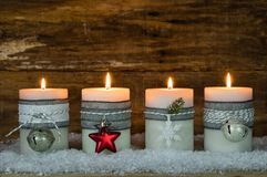 Christmas candles decorated with ornaments for Advent Season. Burning Christmas candlelights for festive Advent season, fourth Advent Royalty Free Stock Photography