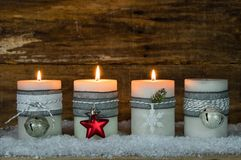 Christmas candles decorated with ornaments for Advent Season royalty free stock images