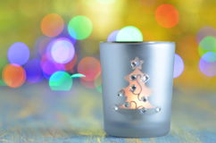Burning Christmas lantern on magical bokeh background Royalty Free Stock Images