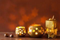Burning christmas lanterns and gifts background Stock Photos