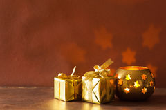 Burning christmas lanterns and gifts background Royalty Free Stock Image