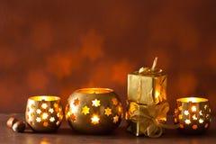 Burning christmas lanterns and gifts background Royalty Free Stock Image