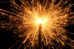 Burning Christmas sparkler, Bengal fire. Royalty Free Stock Images
