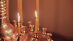 Burning church candles on a candlestick during church services. Burning church candles on a candlestick during church services stock footage