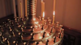 Burning church candles on a candlestick during church services. Burning church candles on a candlestick during church services stock video