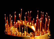 Burning church candles Royalty Free Stock Photography