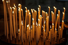 Burning church candles on dark background, christian symbol. Royalty Free Stock Photo
