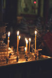 Burning church candles. Royalty Free Stock Image