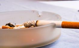 Burning cigarette royalty free stock photos