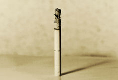 Burning cigarette. On grungy background Royalty Free Stock Image
