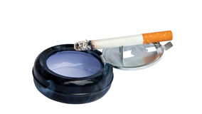 Burning cigarette in the ashtray. Stock Photography