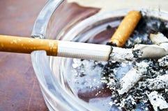Burning cigarette in ashtray Royalty Free Stock Photo