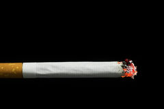 Burning cigarette stock photos