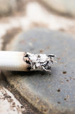 Burning cigarette Stock Images