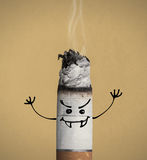 Burning cigarette and funny character Stock Image