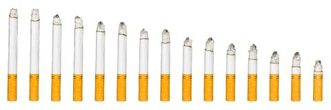 Burning cigarette on isolated white background banner composition photography Royalty Free Stock Image