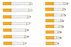 Burning cigarette on isolated white background composition photography Stock Images