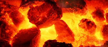 Burning coal. Picture of a fire. Burning coal in fireplace Stock Photography