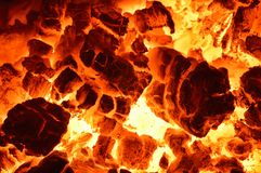 Burning coal. Close up of red hot coals glowed in the stove royalty free stock image