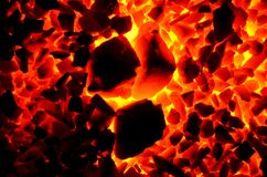 Burning coal anthracite of coarse and fine fractions, as a background. Stock Images