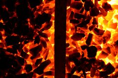The texture of burning coal anthracite is divided in half by a steel product.