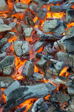Burning coal. Glowing embers smoldering in the fireplace Stock Photography