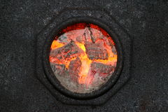 Burning coal hole Stock Photos