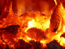 Burning coals. Hot burning coals and flames in the fireplace Royalty Free Stock Photography