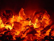 Burning coals. Hot burning coals in the fireplace Royalty Free Stock Photos