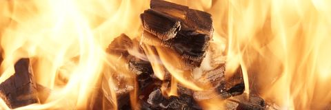Burning Coals close-up Stock Images