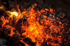 Burning coals. Burning coals close up. Fire and embers background Stock Photo