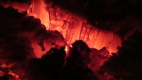 Burning coals. Closeup view of red hot glowing wood inside stove stock footage