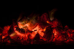 Burning coals with fire flames Stock Photos