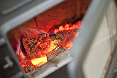 Burning coals of fire wood. In stove Royalty Free Stock Photography