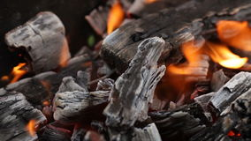 Burning coals, glowing charcoal and flame in barbecue grill stock video
